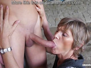 Sizzling old cougar tapes up her young toyboy and sucks him off