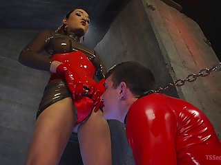 Red latex on portable radio Jessica Fox's body is perfect for this copulation adventure