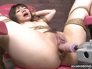All naked and tied up Asian slut gets pussy drilled with a sex machine
