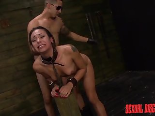 Dom uses his cuffed girl on touching a lock-up aggressively