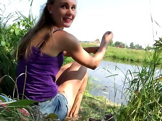 Blistering babe gets bare by the lake