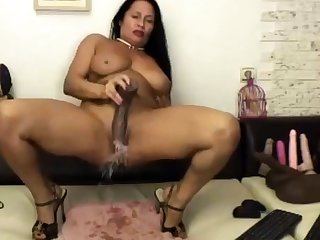 Matured Latina Riding Huge Black Dildo