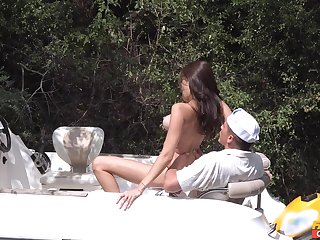Busty honey gets her pussy fucked apt on a boating trip