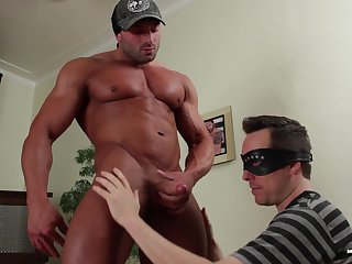 Muscular man pumps disconnected male in the ass increased by cums on his face