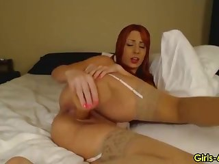 Sexy redhead infant pleasures a dildo with pussy and mouth
