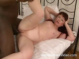 Mature redhead moans with admiration while a black man drills her