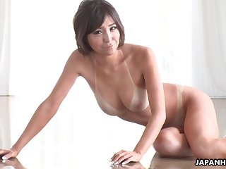Tan lines are sexy and that tanned Asian cutie gives sterling blowjobs