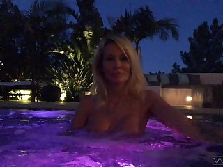 Go-go Jessica Drake gives an interview in the pool