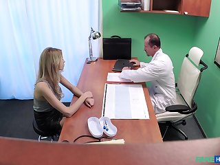 Naughty doctor fucks his sexy blonde patient from behind. Spy cam