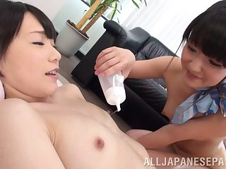 Several Japanese lesbian friends play with everlastingly other and sex toys