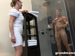 Ancient woman with high intercourse drive enjoys watching young man pretty a shower before having intercourse