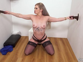 Blonde floosie Kay Transporter drops on her knees to please 2 black dicks