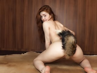 Bewitching tot Jia Lissa plays with a furry-tailed butt plug