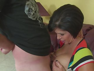 Stacked mature girl Shay Fox titty fucks and gives two lower world of a handjob
