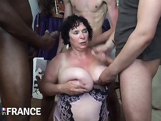Horny granny fucked by duo undaunted young guys