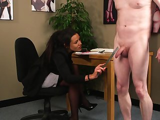 Brunette works this guy's dick while still seated clothed