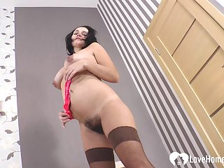 MILF strips off completeness but say no to stockings and high heels before masturbating.