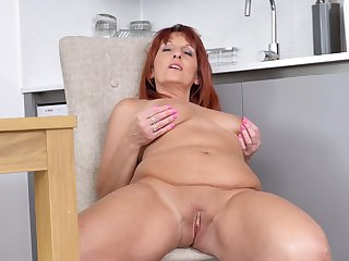 Adult stands nude on cam for a sexy masturbation play